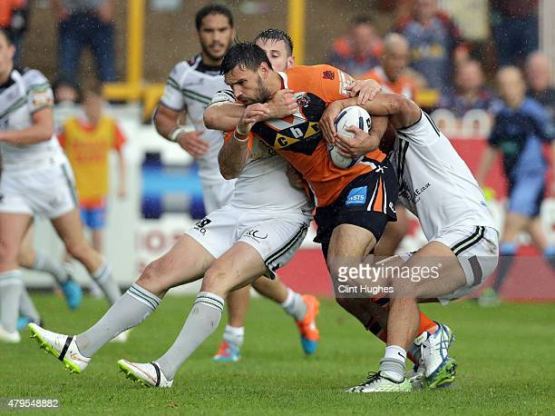 Matt Cook of Castleford Tigers is tackled by a determined Widnes Vikings defence during the First Utility Super League match between Castleford...