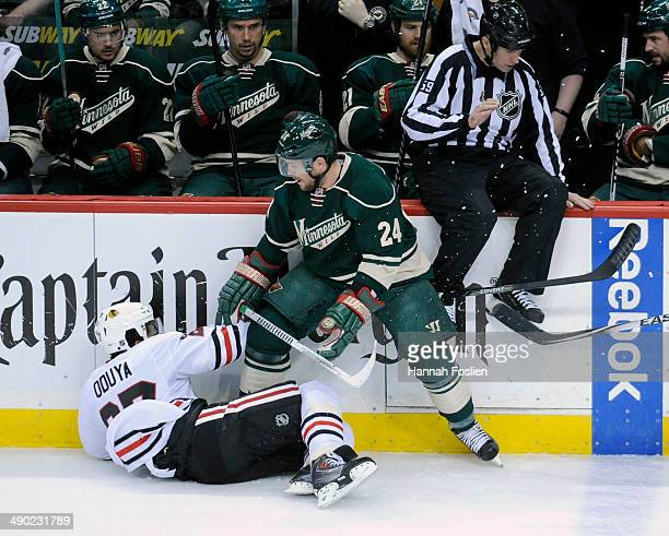 Matt Cooke of the Minnesota Wild knocks down Johnny Oduya of the Chicago Blackhawks during the first period in Game Six of the Second Round of the...