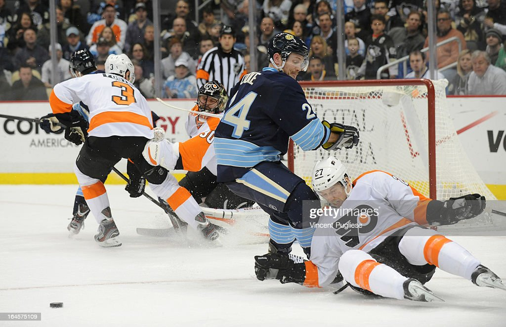 Matt Cooke #24 of the Pittsburgh Penguins collides with Bruno Gervais #27 of the Philadelphia Flyers during the first period on March 24, 2013 at the CONSOL Energy Center in Pittsburgh, Pennsylvania.