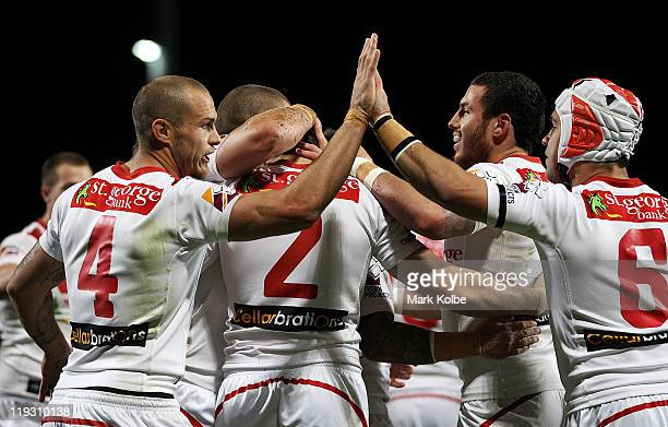 Matt Cooper and Jamie Soward of the Dragons celebrate after Brett Morris of the Dragons scored a try during the round 19 NRL match between the St...