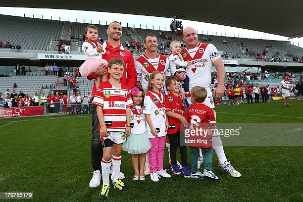 Matt Cooper Nathan Fien and Michael Weyman of the Dragons pose with members of their families after the round 26 NRL match between the St George...