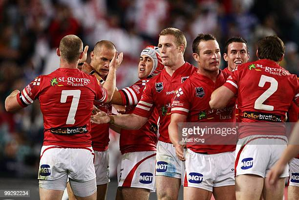 Matt Cooper of the Dragons celebrates with team mates after scoring a try during the round 10 NRL match between the CanterburyBankstown Bulldogs and...