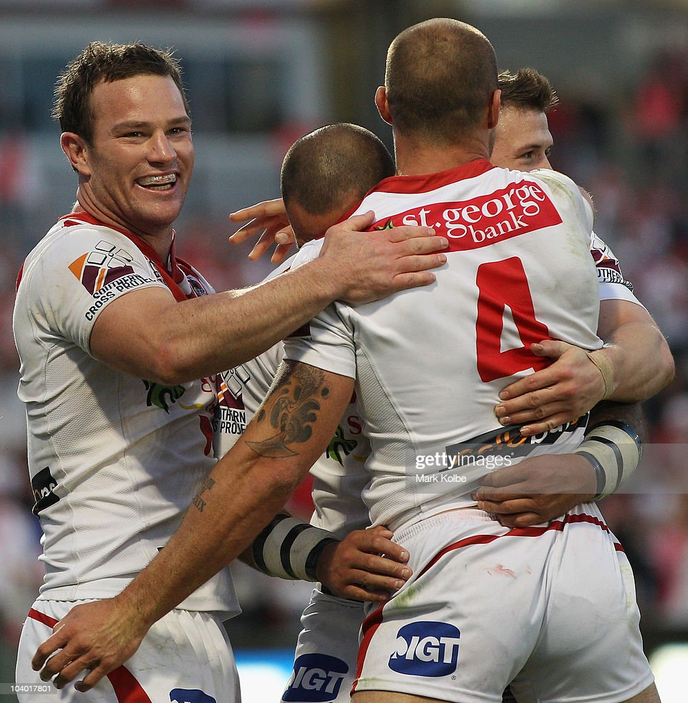 Matt Cooper of the Dragons is congratulated by his team mates after he scored a try during the NRL Fourth Qualifying Final match between the St George Illawarra Dragons and the Manly Warringah Sea Eagles at WIN Jubilee Stadium on September 12, 2010 in Sydney, Australia.