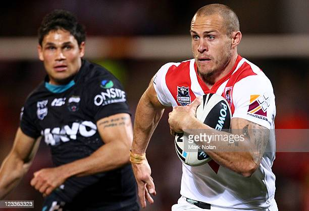Matt Cooper of the Dragons makes a line break during the round 26 NRL match between the St George Illawarra Dragons and the Penrith Panthers at WIN...