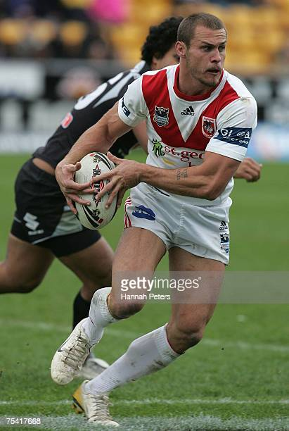 Matt Cooper of the Dragons runs with the ball during the round 18 NRL match between the Warriors and the St George Illawarra Dragons at Mt Smart...
