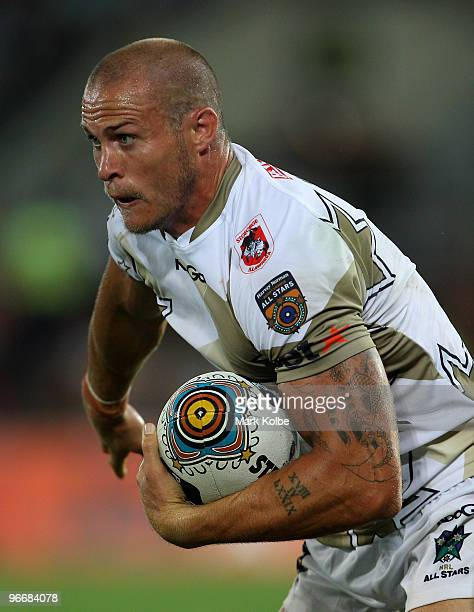 Matt Cooper of the NRL All Stars runs the ball during the Indigenous All Stars and the NRL All Stars match at Skilled Park on February 13, 2010 on...
