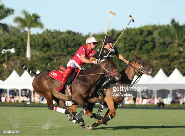 Matt Coppola of Tackeria and Sugar Erskine of CocaCola ride up field during the Herbie Pennell Cup on December 30 2017 at the International Polo Club...
