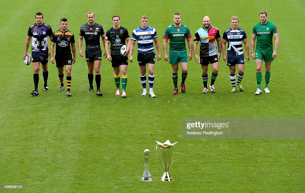 Matt Corker of London Welsh, Matt Mullan of Wasps, Alistair Hargreaves of Saracens, George North of Northampton Saints, Stuart Hooper of Bath Rugby, Ed Slater of Leicester Tigers, Joe Marler of Harlequins, Dan Braid of Sale Sharks and George Skivington of London Irish walk towards the two trophies during the 2014/15 European Rugby Champions Cup and European Rugby Challenge Cup Tournament Launch at The Twickenham Stoop on October 8, 2014 in London, England.