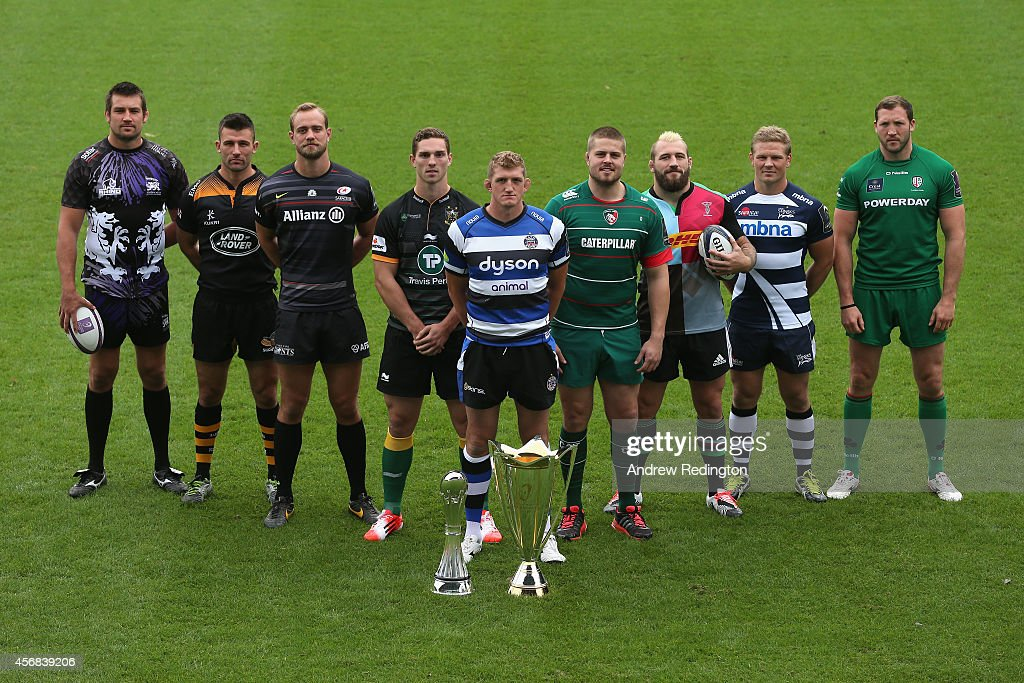 Matt Corker of London Welsh, Matt Mullan of Wasps, Alistair Hargreaves of Saracens, George North of Northampton Saints, Stuart Hooper of Bath Rugby, Ed Slater of Leicester Tigers, Joe Marler of Harlequins, Dan Braid of Sale Sharks and George Skivington of London Irish pose with the the two trophies during the 2014/15 European Rugby Champions Cup and European Rugby Challenge Cup Tournament Launch at The Twickenham Stoop on October 8, 2014 in London, England.