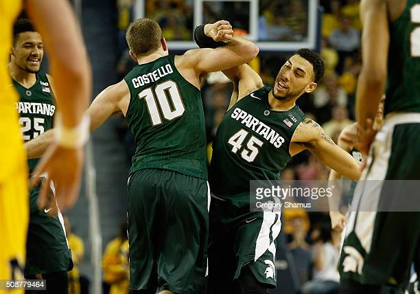 Matt Costello of the Michigan State Spartans celebrates a second half dunk with Denzel Valentine while playing the Michigan Wolverines at Crisler...