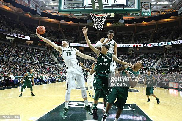 Matt Costello of the Michigan State Spartans grabs a rebound against the Eastern Michigan Eagles at the Breslin Center on December 17, 2014 in East...
