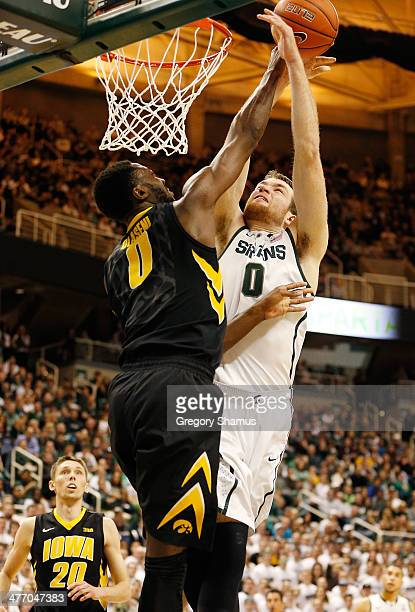 Matt Costello of the Michigan State Spartans tries to dunk over Gabriel Olaseni of the Iowa Hawkeyes during the second half at the Jack T Breslin...
