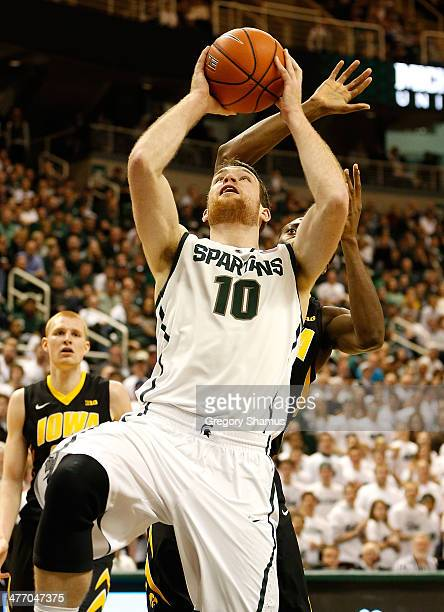 Matt Costello of the Michigan State Spartans tries to get a second half shot off while playing the Iowa Hawkeyes at the Jack T Breslin Student Events...