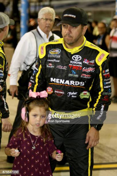 Matt Crafton driver of the and his daughter Elladee on pit road before the start of the Ford EcoBoost 200 at HomesteadMiami Speedway on November 17...