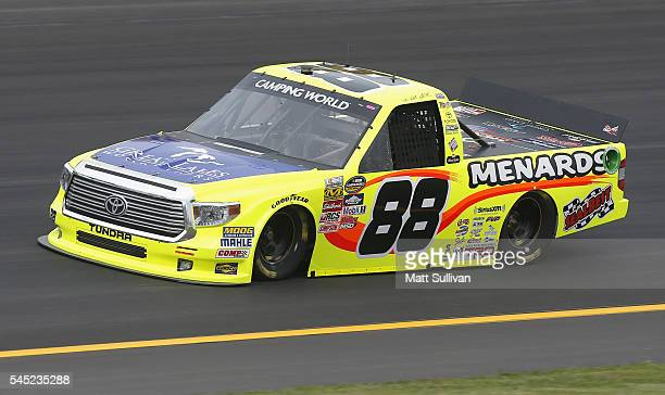 Matt Crafton driver of the Great Lakes Flooring/Menards Toyota practices for the NASCAR Camping World Truck Series Buckle Up In Your Truck 225 at...