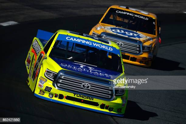 Matt Crafton driver of the Great Lakes Floors/Menards Toyota leads Todd Gilliland driver of the Pedigree Toyota during the NASCAR Camping World Truck...