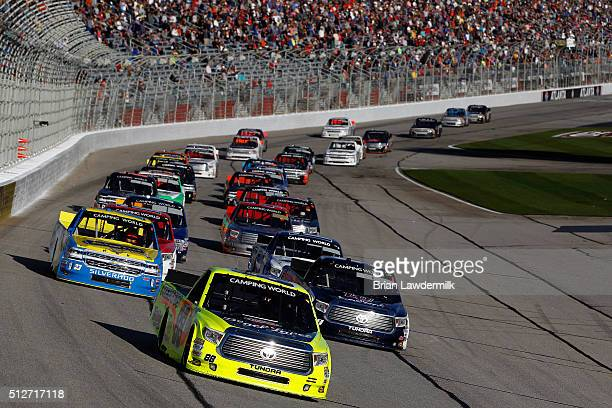 Matt Crafton driver of the Hormel/Menards Toyota leads a pack of trucks during the NASCAR Camping World Truck Series Great Clips 200 at Atlanta Motor...