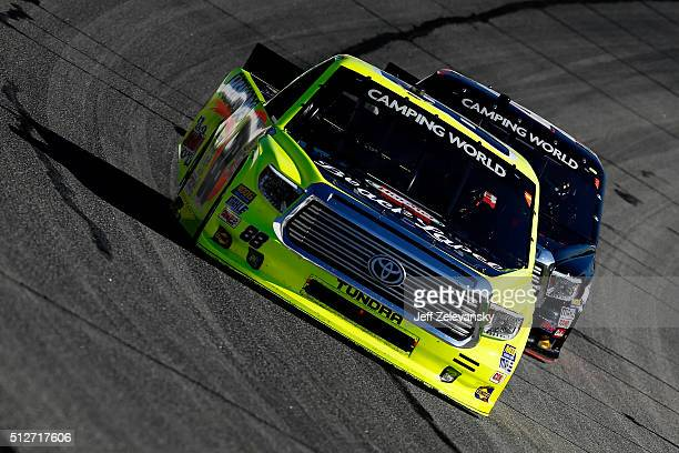 Matt Crafton driver of the Hormel/Menards Toyota leads Christopher Bell driver of the JBL Toyota during the NASCAR Camping World Truck Series Great...