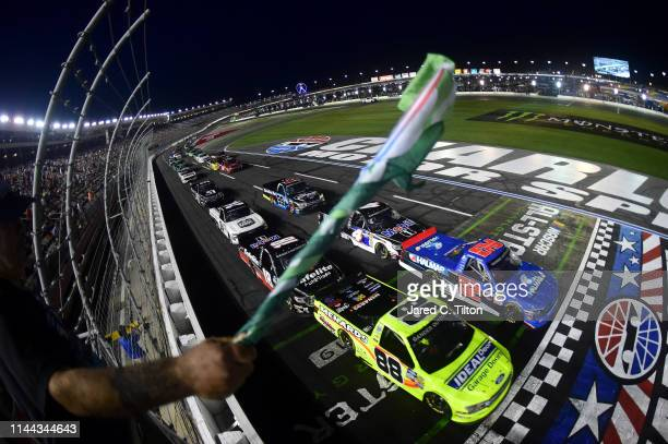 Matt Crafton driver of the Ideal Door/Menards Ford and Stewart Friesen driver of the Halmar International Chevrolet lead the field to the green flag...
