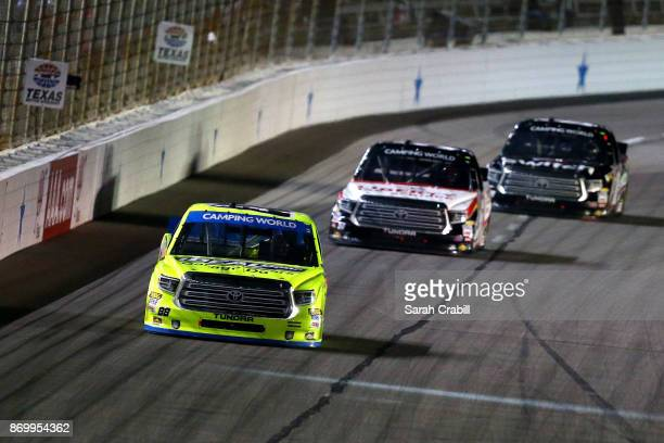 Matt Crafton driver of the Ideal Door/Menards Toyota leads the Myatt Snider driver of the Liberty Tax Service Toyota during the NASCAR Camping World...