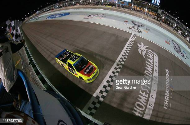 Matt Crafton driver of the Jack Links/Menards Ford takes the crosses the finish line to win the NASCAR Gander Outdoors Truck Series Championship at...