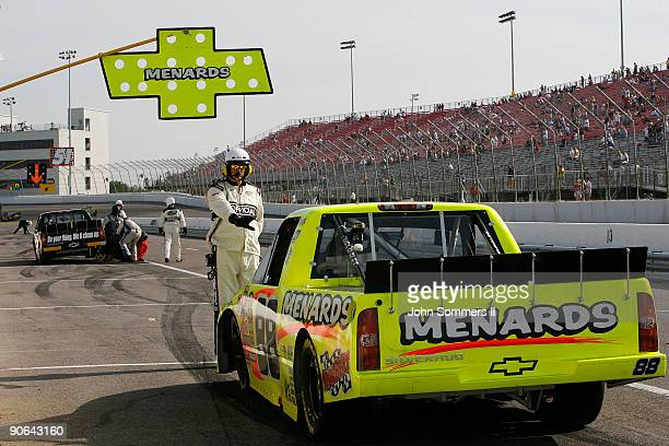 Matt Crafton driver of the Menards/NIBCO Chevrolet is held in the pits by officials after being black flag during the Camping World truck race Copart...