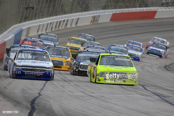 Matt Crafton driver of the Rip It/Menards Ford and Johnny Sauter driver of the Allegiant Airlines Chevrolet lead a pack of trucks during the NASCAR...