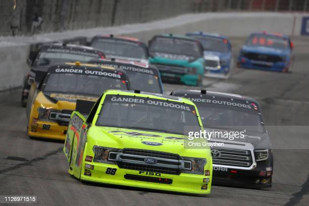 Matt Crafton driver of the Rip It/Menards Ford leads a pack of cars during the NASCAR Gander Outdoors Truck Series Ultimate Tailgating 200 at Atlanta...
