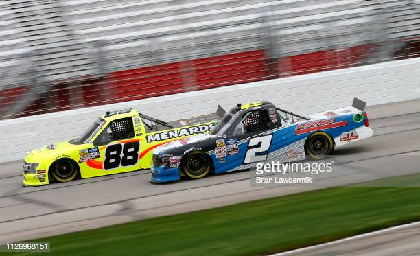 Matt Crafton driver of the Rip It/Menards Ford leads Sheldon Creed driver of the AM Ortega/United Rentals Chevrolet during the NASCAR Gander Outdoors...
