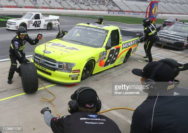 Matt Crafton driver of the Rip It/Menards Ford pits during the NASCAR Gander Outdoors Truck Series Ultimate Tailgating 200 at Atlanta Motor Speedway...