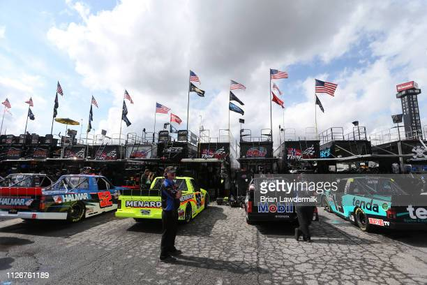 Matt Crafton driver of the Rip It/Menards Ford waits to practice during practice for the NASCAR Gander Outdoor Truck Series Ultimate Tailgating 200...