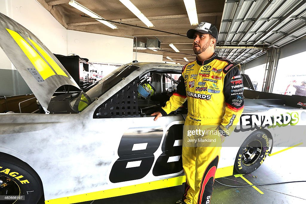 Matt Crafton, driver of the #88 Thorsport Racing Toyota stands in the garage during NASCAR Preseason Thunder at Daytona International Speedway on January 14, 2014 in Daytona Beach, Florida.