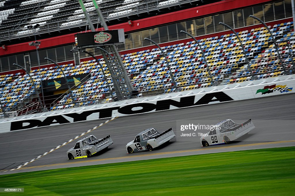 Matt Crafton, driver of the #88 Thorsport Toyota, leads Johnny Sauter, driver of the #98 Thorsport Toyota, and Ross Chastain, driver of the #13 Thorsport Toyota, during NASCAR Preseason Thunder at Daytona International Speedway on January 14, 2014 in Daytona Beach, Florida.