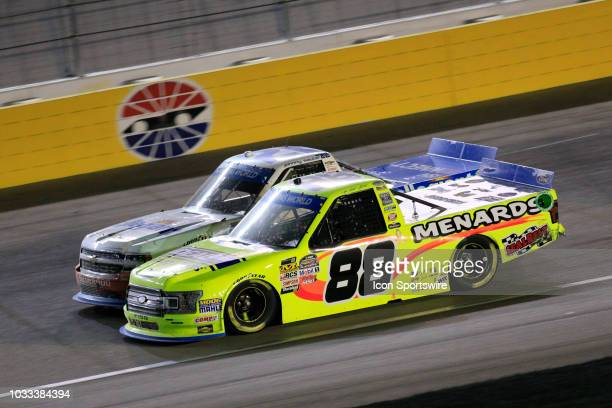 Matt Crafton Ideal Door Menards ThorSport Racing Ford F150 and Johnny Sauter Allegiant Chevrolet Silverado race sidebyside late for the lead during...