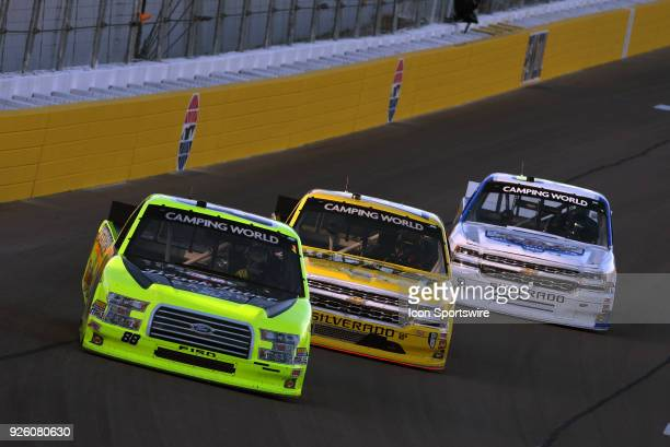 Matt Crafton ThorSport Ford F150 Cody Coughlin GMS Racing Chevrolet Silverado and Jordan Anderson Toyota Tundra dive into turn one during practice...