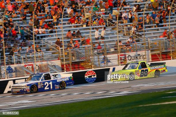 Matt Crafton ThorSport Racing Rip It / Menards Ford F150 pressures Johnny Sauter GMS Racing Allegiant Airlines Chevrolet Silverado during the NASCAR...