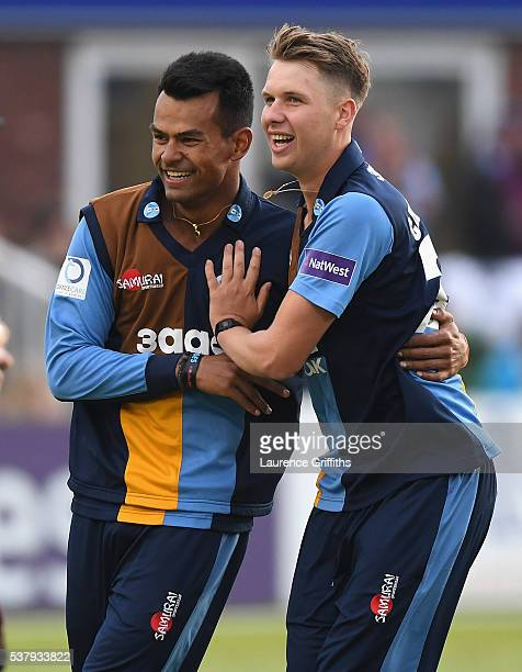 Matt Critchley of Derbyshire Falcons is congratulated by Shiv Thakor on taking the wicket of Ben Raine of Leicestershire Foxes during the NatWest T20...
