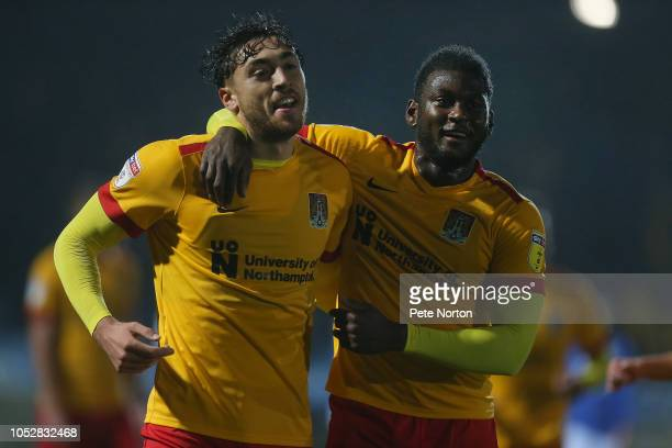 Matt Crooks of Northampton Town celebrates with team mate Aaron Pierre after scoring his second goal during the Sky Bet League Two match between...
