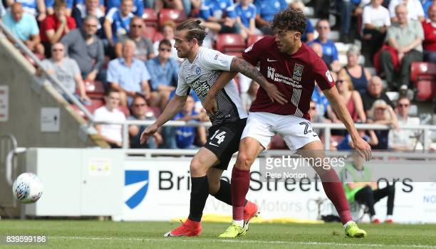 Matt Crooks of Northampton Town contests the ball with Jack Marriott of Peterborough United during the Sky Bet League One match between Northampton...