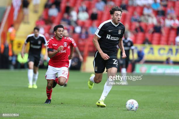 Matt Crooks of Northampton Town moves forward with the ball away from Jay Dasilva of Charlton Athletic during the Sky Bet League One match between...