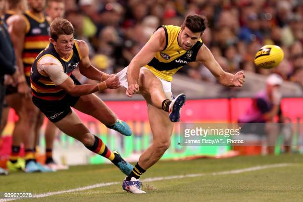 Matt Crouch of the Crows tackles Trent Cotchin of the Tigers during the 2018 AFL round 02 match between the Adelaide Crows and the Richmond Tigers at...