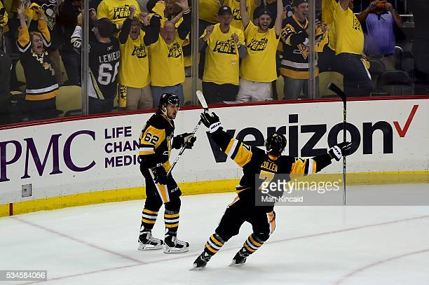 Matt Cullen and Carl Hagelin of the Pittsburgh Penguins celebrate in the third period against the Tampa Bay Lightning in Game Seven of the Eastern...