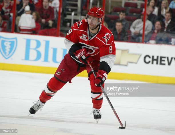 Matt Cullen of the Carolina Hurricanes carries the puck during their NHL game gainst the New York Islanders at RBC Center in Raleigh North Carolina...