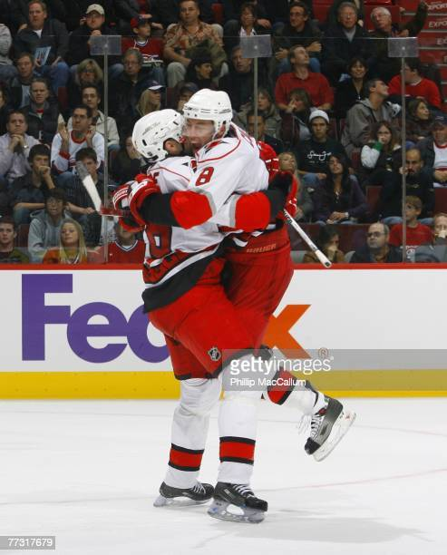 Matt Cullen of the Carolina Hurricanes celebrates his goal against the Montreal Canadiens with teammate Erik Cole during second period action of a...