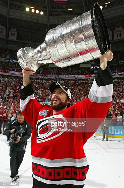 Matt Cullen of the Carolina Hurricanes celebrates with the Stanley Cup after defeating the Edmonton Oilers in game seven of the 2006 NHL Stanley Cup...