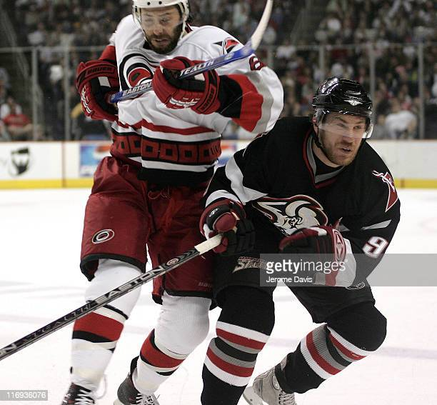 Matt Cullen of the Carolina Hurricanes checks Sabres' Derek Roy during game 4 of the Eastern Conference Finals versus the Buffalo Sabres at the HSBC...