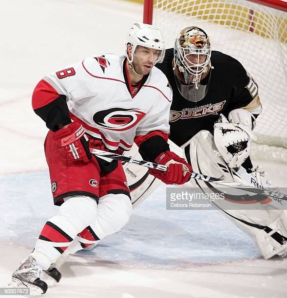 Matt Cullen of the Carolina Hurricanes defends in front of the crease against JeanSebastien Giguere of the Anaheim Ducks during the game on November...