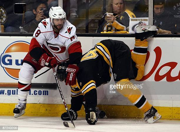 Matt Cullen of the Carolina Hurricanes shoves Aaron Ward of the Boston Bruins during Game Seven of the Eastern Conference Semifinal Round of the 2009...