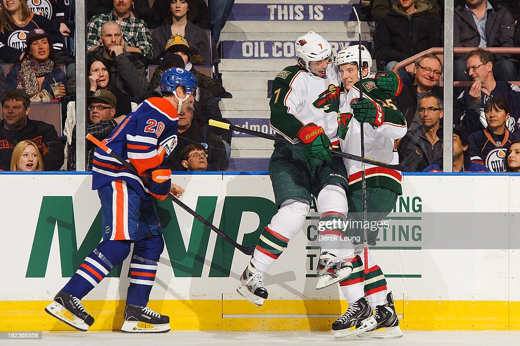 Matt Cullen #7 of the Minnesota Wild celebrates his goal on Devan Dubnyk #40 of the Edmonton Oilers during an NHL game at Rexall Place on February 21, 2013 in Edmonton, Alberta, Canada.