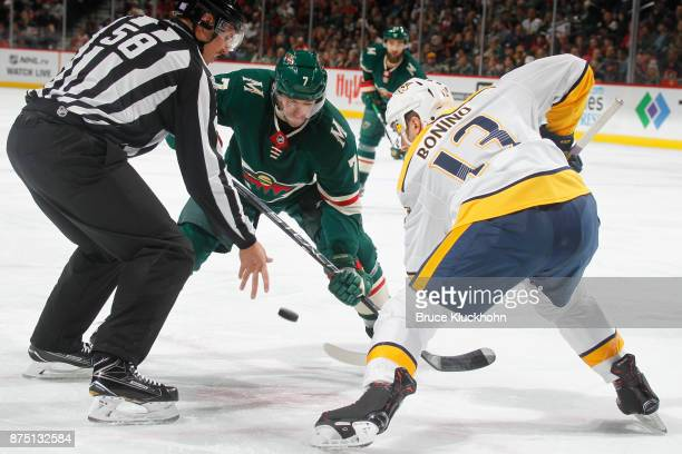 Matt Cullen of the Minnesota Wild takes a faceoff against Nick Bonino of the Nashville Predators during the game at the Xcel Energy Center on...